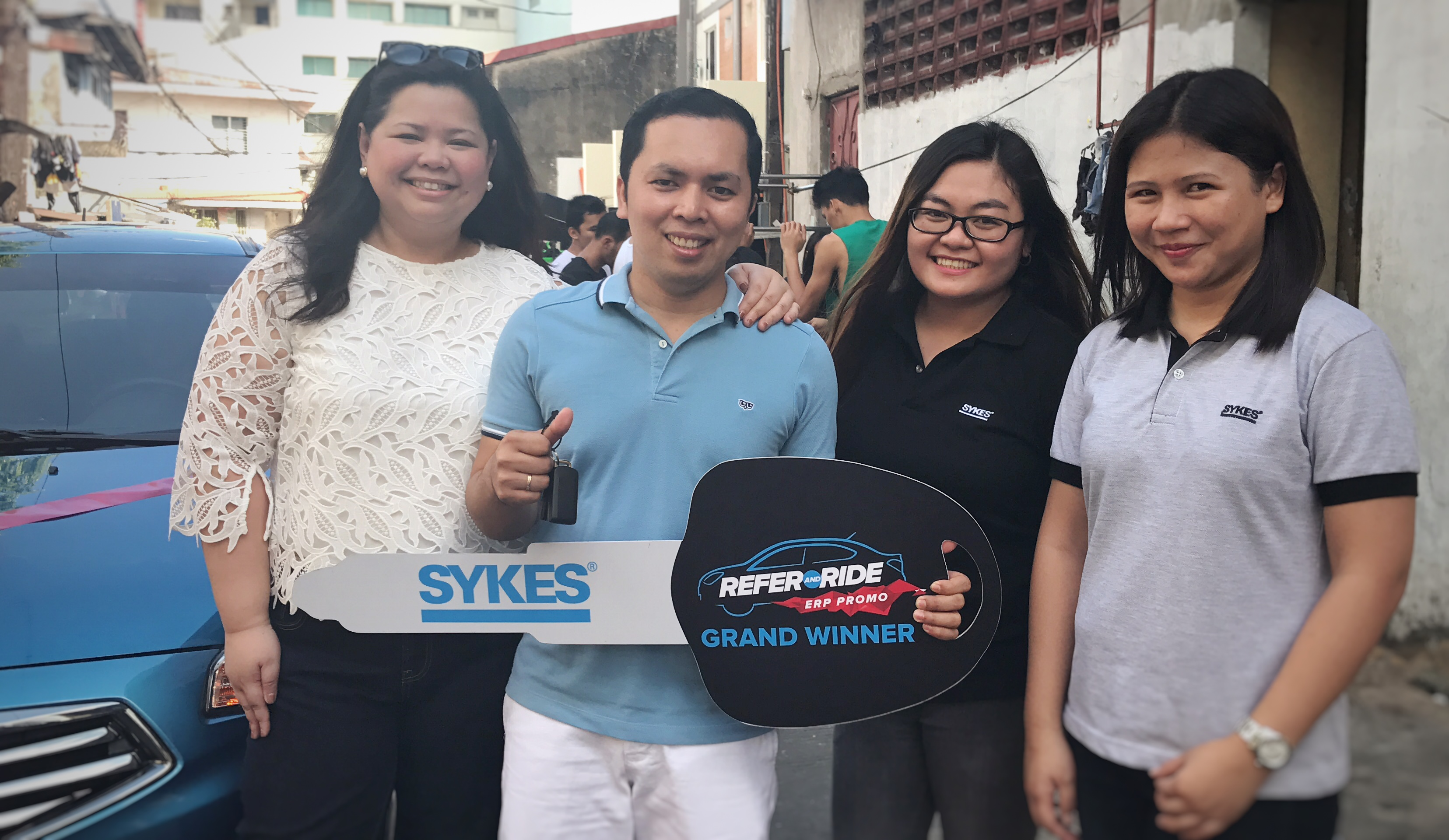 SYKES Gives Away a Brand-New Car to Lucky Employee