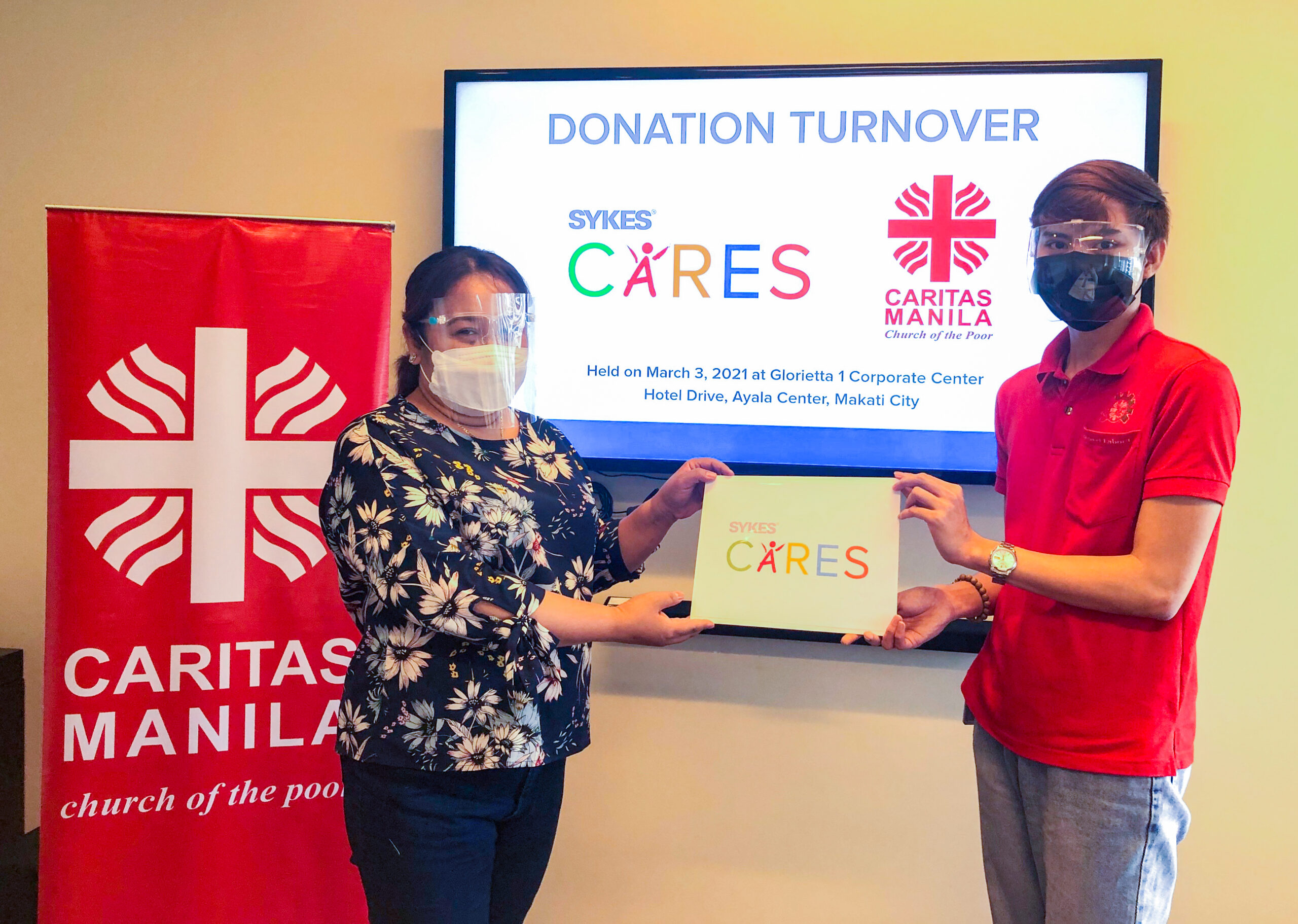 SYKES turnovers its charitable donation to Caritas Manila for the victims of the typhoon